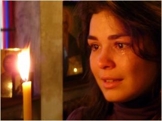 Сълза и свещ в храма